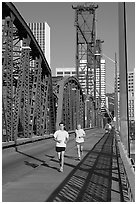 Men jogging on Hawthorne Bridge. Portland, Oregon, USA ( black and white)