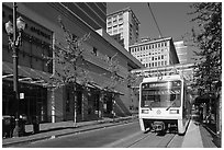 Street with tram, downtown. Portland, Oregon, USA (black and white)