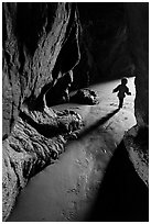 Infant walking out of sea cave. Bandon, Oregon, USA ( black and white)