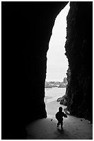 Infant and sea cave opening from inside. Bandon, Oregon, USA ( black and white)