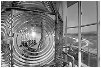 Light inside Cape Blanco Lighthouse tower and landscape. Oregon, USA ( black and white)