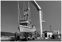 Fishing boat lifted onto deck, Port Orford. Oregon, USA ( black and white)