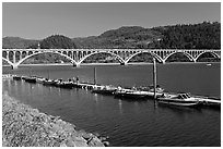 Boat deck and Isaac Lee Patterson Bridge over the Rogue River. Oregon, USA (black and white)