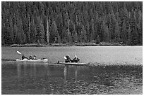 Parents kayaking with children in tow, Devils Lake. Oregon, USA ( black and white)