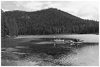 Family kayaking on Devils Lake. Oregon, USA ( black and white)