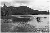 Parents towing children in kayak, Devils Lake. Oregon, USA ( black and white)