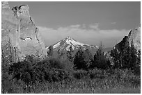 Snow-capped volcano seen between rock pinnacles. Smith Rock State Park, Oregon, USA ( black and white)