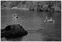 Two Rafts passing boulder, McKenzie river. Oregon, USA ( black and white)