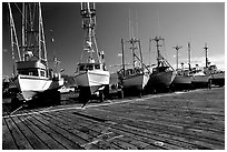 Boats on the dry deck of Port Orford. Oregon, USA (black and white)