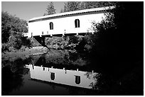 White covered Bridge reflected in river, Willamette Valley. Oregon, USA ( black and white)