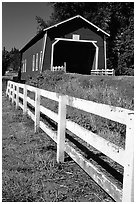 Fence and red covered bridge, Willamette Valley. Oregon, USA ( black and white)
