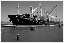 Cargo ship loading floated timber. Oregon, USA ( black and white)