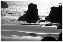 Rocks, water reflections, and beach, late afternoon. Bandon, Oregon, USA ( black and white)