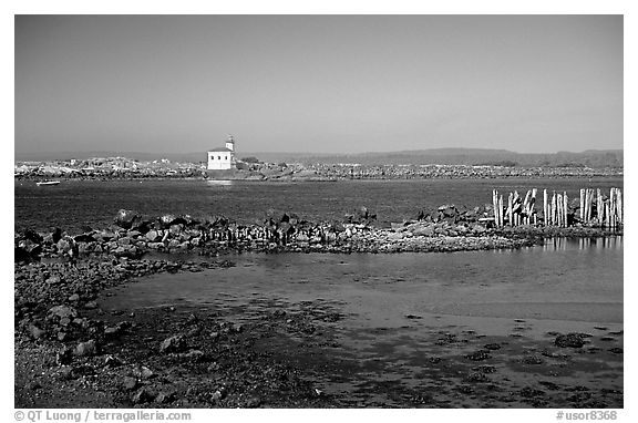 Coquille River estuary with lighthouse. Bandon, Oregon, USA (black and white)