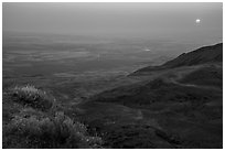 Sun rising in haze over Saddle Mountain, Hanford Reach National Monument. Washington ( black and white)