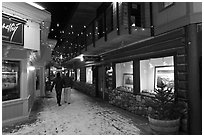 Alley with art galleries, winter night. Jackson, Wyoming, USA (black and white)