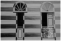 Red window shutters and striped walls, Parc De Bombas, Ponce. Puerto Rico (black and white)