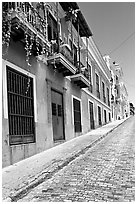 Old cobblestone street and pastel-colored houses, old town. San Juan, Puerto Rico (black and white)