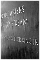 Words from bibical quote and Martin Luther King name, Civil Rights Memorial. Montgomery, Alabama, USA ( black and white)