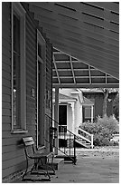Porch, bench, and buildings in Old Alabama Town. Montgomery, Alabama, USA ( black and white)