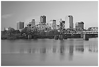 Skyline and bridge with reflections in river at sunrise. Little Rock, Arkansas, USA (black and white)