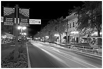 Historic district avenue with car lights. Hot Springs, Arkansas, USA (black and white)
