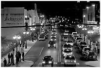 Central avenue with lots of cars and pedestrican on street. Hot Springs, Arkansas, USA (black and white)