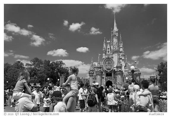 Girls on fathers shoulders, Cinderella Castle. Orlando, Florida, USA (black and white)