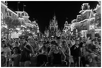 Main Street at night with crowds and castle. Orlando, Florida, USA ( black and white)