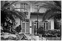 Facade of Hemingway's house. Key West, Florida, USA ( black and white)