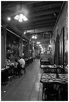 Cuban restaurant at night, Mallory Square. Key West, Florida, USA (black and white)