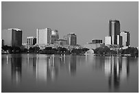Skyline at dawn from lake Eola. Orlando, Florida, USA ( black and white)
