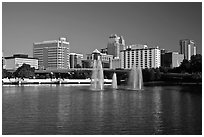 Fountains and morning skyline from Lake Lucerne. Orlando, Florida, USA ( black and white)