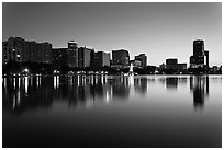 Orlando skyline at sunset reflected in lake Eola. Orlando, Florida, USA ( black and white)