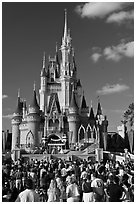Tourists attend stage musical in front of Cindarella castle. Orlando, Florida, USA ( black and white)