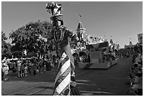 Character on stilts during parade, Main Street. Orlando, Florida, USA ( black and white)