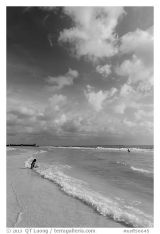 Woman and wave, Fort De Soto beach. Florida, USA