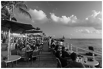 Waiting for sunset with drink in hand on Mallory Square. Key West, Florida, USA ( black and white)