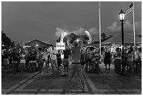 Street entertainer and spectators. Key West, Florida, USA ( black and white)