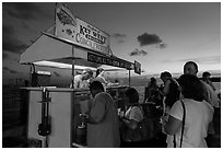 People buying food at stand on Mallory Square. Key West, Florida, USA (black and white)