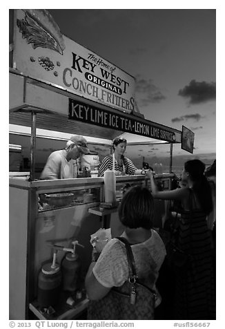 Key West conch fritters food stand at sunset. Key West, Florida, USA (black and white)