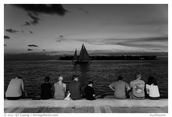 Tourists watching ocean after sunset, Mallory Square. Key West, Florida, USA
