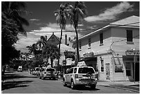 Street with pink cabs. Key West, Florida, USA ( black and white)