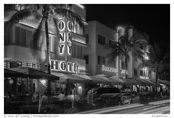 Art Deco hotels colorfully illuminated and traffic light trails, South Beach, Miami Beach. Florida, USA (black and white)