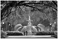 Fountain in Forsyth Park with couple standing. Savannah, Georgia, USA ( black and white)