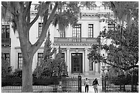 Women walking out of mansion. Savannah, Georgia, USA ( black and white)
