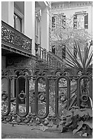 Fence and yard in front of historic house. Savannah, Georgia, USA (black and white)