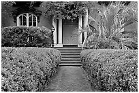 House entrance with garden, historical district. Savannah, Georgia, USA (black and white)
