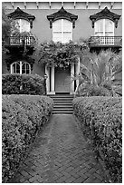 Garden and historic house entrance. Savannah, Georgia, USA (black and white)
