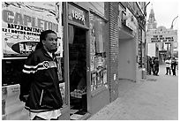 Man standing in front of music store, sweet Auburn. Atlanta, Georgia, USA ( black and white)